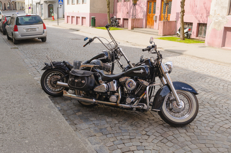 sportster: ALESUND, NORWAY - JUNE 3, 2013: Two customized harley davidson motorbikes parked near a building entrance