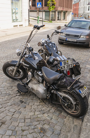 sportster: ALESUND, NORWAY - JUNE 3, 2013: Two customized harley davidson motorbikes parked in the streets of Alesund, Norway