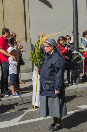 holy week: VALLADOLID, SPAIN - MARCH 29, 2015: A nun marching in a procession in Valladolid, Spain. Valladolid has some os the most famous processions in the spanish holy week