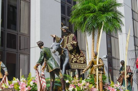 imagery: Sacred imagery in Valladolids holy week procession. The Triumphal Entry of Jesus into Jerusalem also known as la borriquilla. Old Polychromed sculpture in wood and other materials