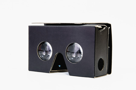 mobile headset: Cardboard virtual reality glasses in black for use with a mobile phone. Vr headset made with cardboard