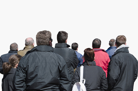 spectator: Spectators. Back view of people watching a performance in the street