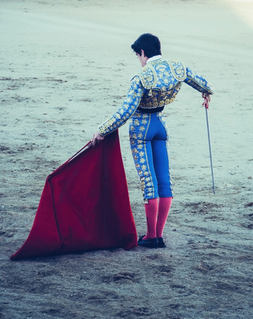 corrida: A bullfighter awaiting for the bull in the bullring with estoque and muleta. Corrida de toros Stock Photo