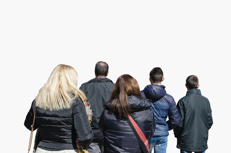spectator: Back view of some people watching something in the street. Crowd. Spectator Stock Photo