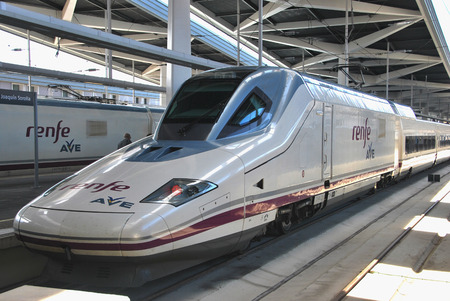 joaquin: VALENCIA, SPAIN - APRIL 16, 2012: AVE hig speed train in Joaquin Sorolla station, Valencia. Most spanish provinces are connected by this modern transportation medium