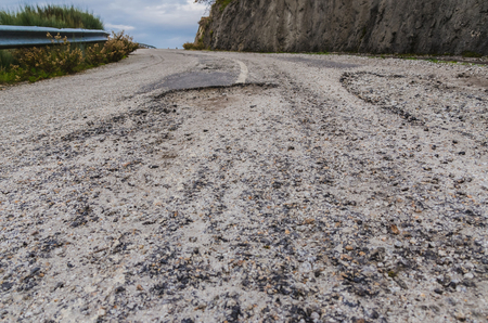 rough road: Rough asphalt road in countryside. Transport concept