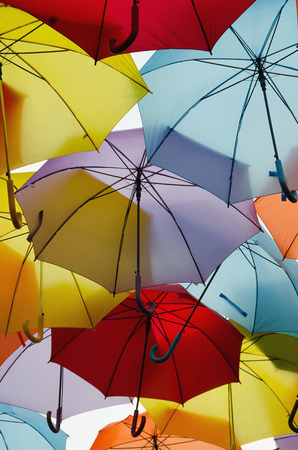 hundreds: Bright colorful hundreds of umbrellas on the sky. Vertical background