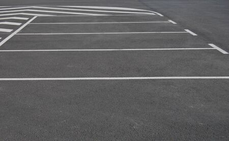 lot: empty parking lots painted in white on a gray pavement