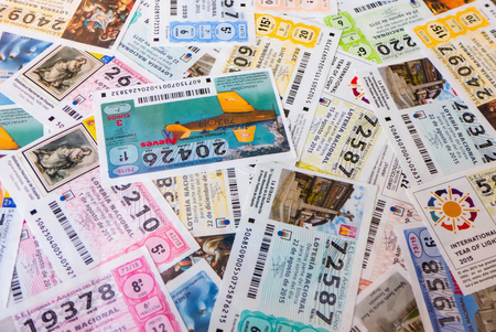 MADRID, SPAIN - MARCH 29, 2016: Spanish national lottery receipts. National lottery is known in Spain as Loteria Nacional and is promoted for loterias y apuestas del estado Stok Fotoğraf - 55474725