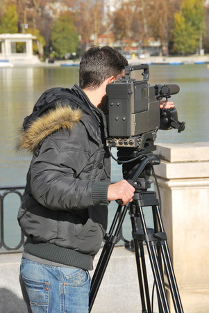 camera operator: Professional cameraman with video camera in shooting process. Digital media recording Stock Photo
