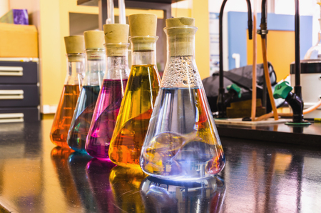closed corks: Chemical liquids in glass bottles. Chemistry, investigation and research.