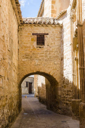 passageway: View on beige stone buildings with passageway in Baeza, Jaen, Andalusia, Spain