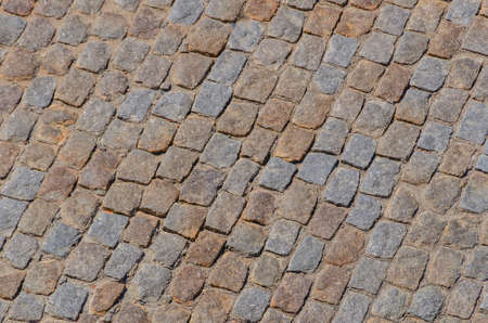 cobbled: Close-up of cobbled pavement in sunlight