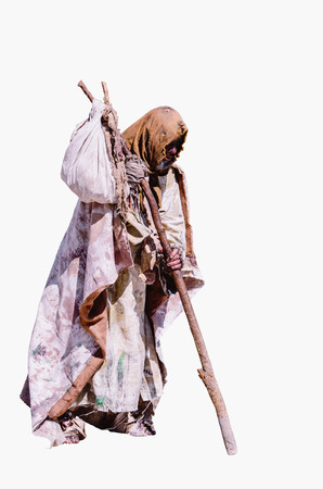 grimy: Portrait of dirty wander walking with stick in rags. grimy vagabond. Isolated Stock Photo