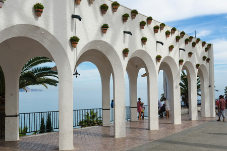People looking at the sea in Balcon de Europa, Nerja. Costa del Sol, Malaga, Andalusia, Spain
