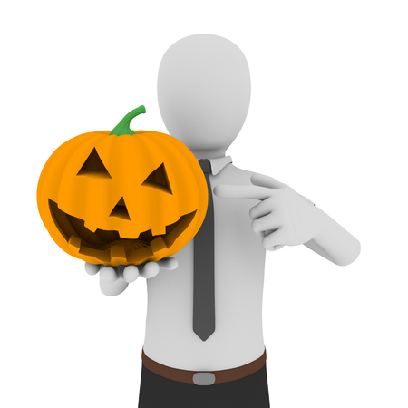 man pointing: a business man pointing to an scary halloween pumpkin