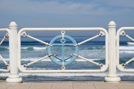 aviles: Metallic fence decorated in white and blue in the beach promenade of Aviles, Asturias, Spain