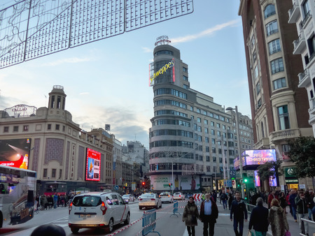 gran via: MADRID, SPAIN - DECEMBER 3: People walking in Gran Via on December 3, 2016 in Madrid, Spain. In Christmas time, gran via is pedestrianized, allowing people walks on the street road not only sidewalk. Gran Vía is one of the main streets of Madrid