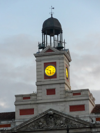 Puerta del sol clock in Madrid. In midnight of december 31 this clock marks the time for eat the famous luck grapes. Spanish people welcome and celebrates new year with this clock