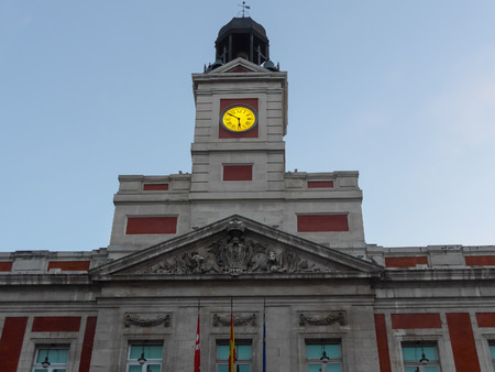 Casa de Correos facade and clock in Puerta del Sol, Madrid. Puerta del Sol is the centre (Km 0) of the radial network of Spanish roads. Spanish people welcome and celebrates new year with this clock