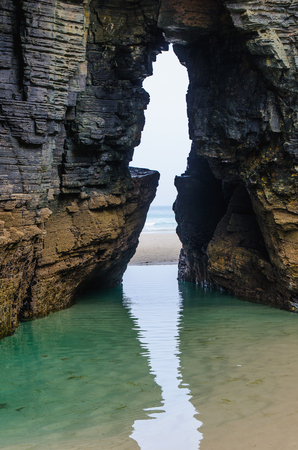 cantabrian: Playa de las catedrales. Natural arch in the rock of the cliffs in Ribadeo, Lugo, Galicia, Spain Stock Photo