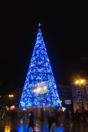 Christmas tree illuminated in Puerta del Sol Madrid. Christmas lighting and decoration in Madrid
