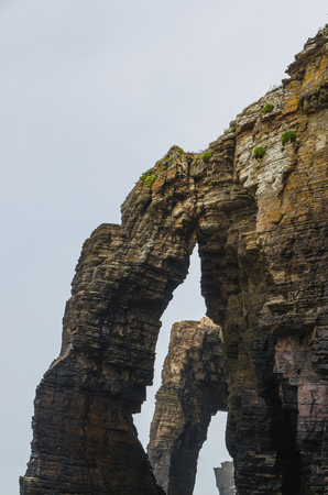 praia: Arches in the cliffs of Cathedrals beach. Playa de las catedrales. Geological formation. Ribadeo, Lugo, Galicia, Spain