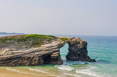 Typical view of natural arch in the rocks of playa de las catedrales. Ribadeo, Lugo, Galicia, Spain Stock Photo