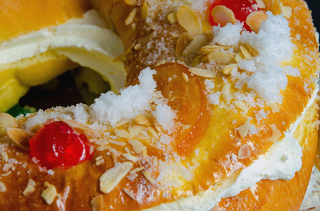 Roscon de reyes, epiphany cake, kings cake. Detail on crystalized or glazed fruit and almond Stock Photo