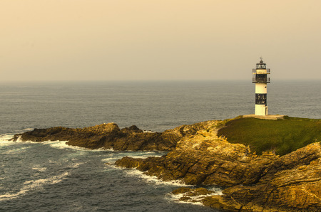 Lighthouse or light tower in the coast of Ribadeo, Galicia, Spain