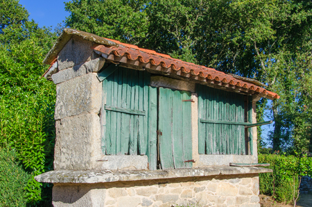 swaddle: Typical galician horreo in palas de rei, galicia, Spain. Horreo is a granary made in wood and stone