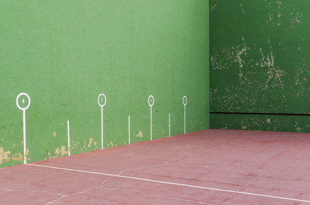 games hand: Typical fronton court painted in green. Fronton is a building where pelota or jai alai is played