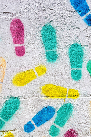 some footprints painted in a concrete white wall. abstract background