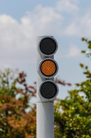 Led lights semaphore. Modern style traffic light in amber sequence. Traffic regulation Stock Photo