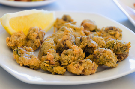 ortiguillas. little sea nettles, tapa of breaded and fried marine anemone. Cadiz, Andalusia, Spain