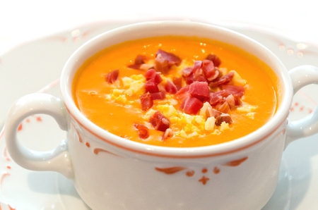 Salmorejo served in a bowl. Typical andalusian cold soup or puree made with tomato, bread, olive oil and garlic. As garnish can be used serrano ham and boiled egg Zdjęcie Seryjne