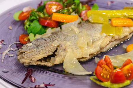 Detail on a pickled trout with salad. Typical spanish recipe of freshwater fish. Salmoninae, Salmonidae
