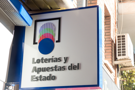MADRID, SPAIN - DECEMBER 5, 2017: Loteria nacional. Official logo on the facade of an spanish national lottery outlet. Loterias y apuestas del estado. Spanish national lottery distributes many cash prizes especially at Christmas time. First prize is calle
