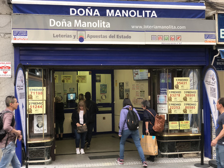 MADRID, SPAIN - MAY 24, 2018: Facade of the most famous spanish national lottery outlet called dona Manolita. Spanish national lottery distributes many cash prizes especially at Christmas time. First prize is called Gordo de Navidad