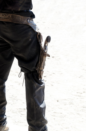 rear view of a cowboy with a gun or pistol in his holster