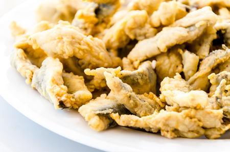 Detail on a plate of marinated, breaded and fried anchovies or boquerones