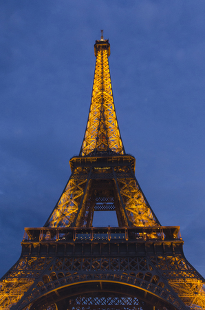 PARIS - SEPTEMBER 18, 2014: Eiffel tower at night on September 18, 2014 in Paris. Eiffel tower is the most known symbol of Paris.