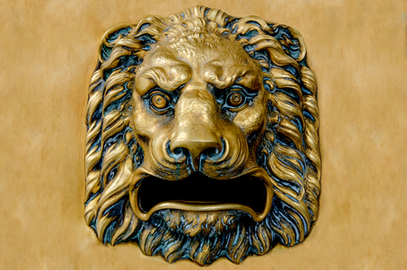 Detail on the head of a lion made in bronze and used as mailbox