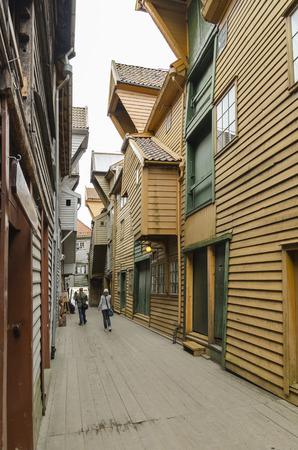 People walking on bryggen streets hanseatic buildings in Bergen