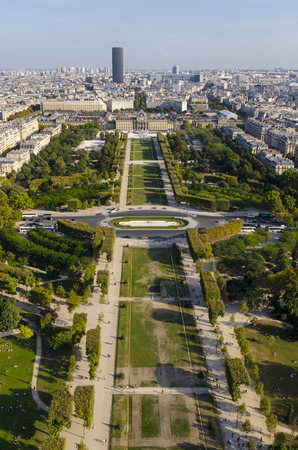View of Champ de mars as seen from Eiffel tower. Paris skyline with Montparnasse tower