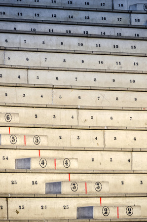 empty numbered concrete blecahers or stands distributed in rows and columns awaiting for audience or spectators