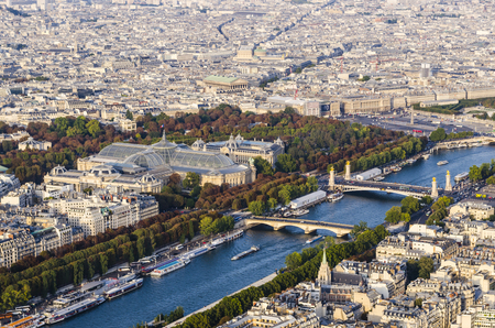 Aerial view on Seine river with Alexander III and Invalides bridges and Grand Palais and Petit Palais in the city of Paris, France Imagens - 117713335