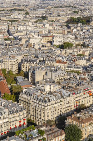 Aerial view of rooftops in the streets of Paris as seen from Eiffel Tower
