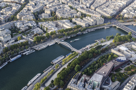 Aerial view on river seine with bridges and touristic ships as seen from eiffel tower. Paris, France