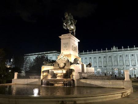 Statue of Felipe IV in Plaza de Oriente in the city Madrid at night